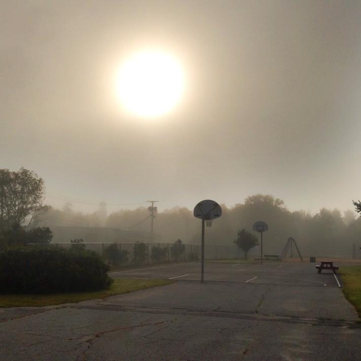 Foggy September morning, schoolyard, Gorham, NH.
