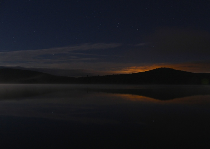 Lights of Berlin, Gorham, and Milan, NH, reflected in Pontook Reservoir.