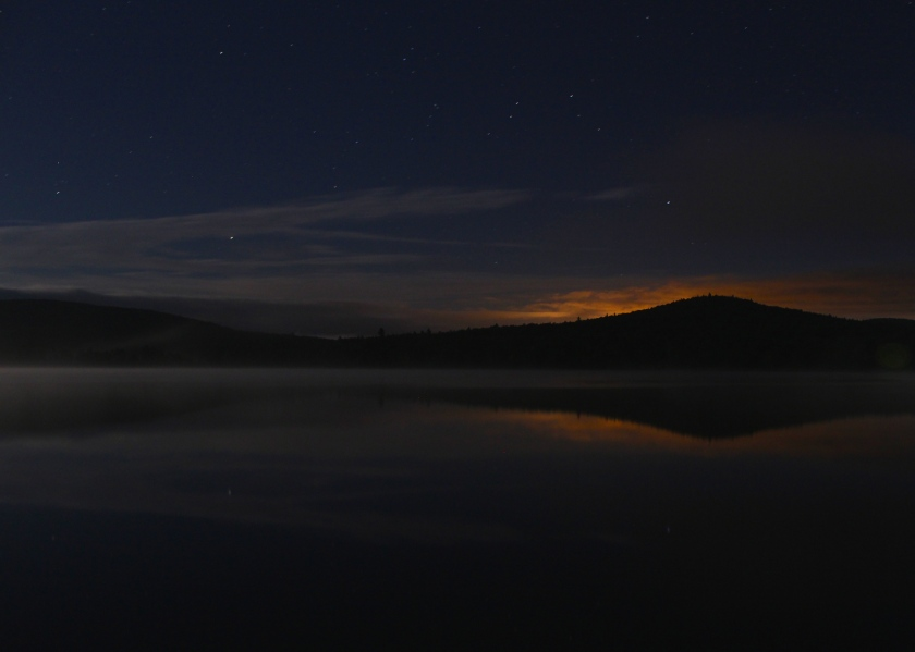Lights of Berlin, Gorham, and Milan, NH, reflected in Pontook Reservoir.
