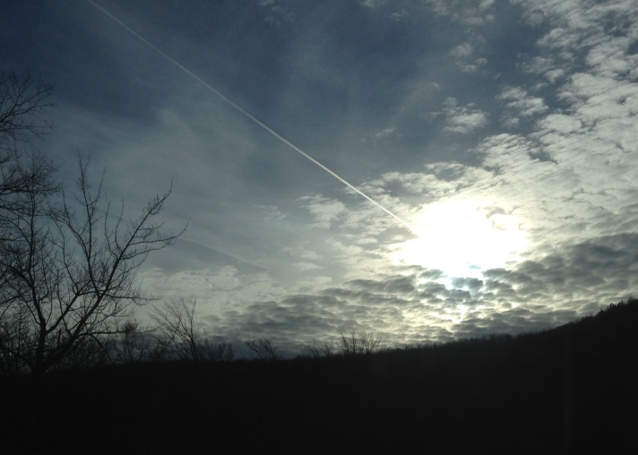 Jet contrail and setting sun, Route 16, Jackson, NH.