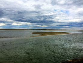 Incoming tide, tidal flats along breakwater to Wood End Lighthouse, Provincetown, Cape Cod, MA.