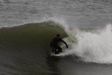 Surfer, eastern shore, Cape Cod, MA.