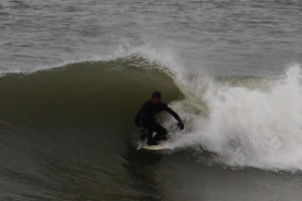 Surfer, eastern shore, Cape Cod, MA.