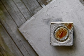 Nut and metal plate on wood, Saint John, NB