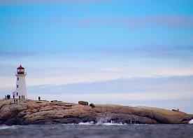 Lighthouse and tourists, Peggy's Cove, Nova Scotia.