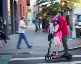 Father and daughter on scooter, Greenwich Village, New York, N.Y.